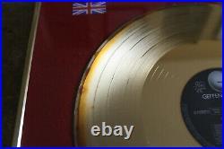 Guns N Roses BPI gold record award presented to Alan Niven