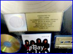 Kiss, Lick It Up Riaa Gold Record Award To Kiss Eric Carr. Gene Simmons