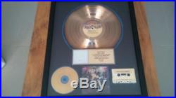 Kiss alive gold record award presented to eric carr