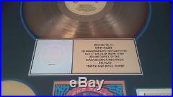 Kiss rock and roll over riaa gold record award presented to eric carr