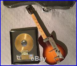 MERLE HAGGARD SIGNED 1950's KAY GUITAR & RIAA GOLD RECORD AWARD