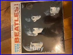 Meet The Beatles St2047 Gold Record Award LP withoriginal shrink wrap & price tag